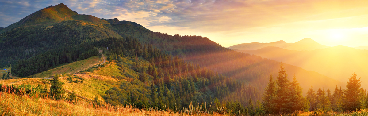 Inspirational sunrise over mountains and forests