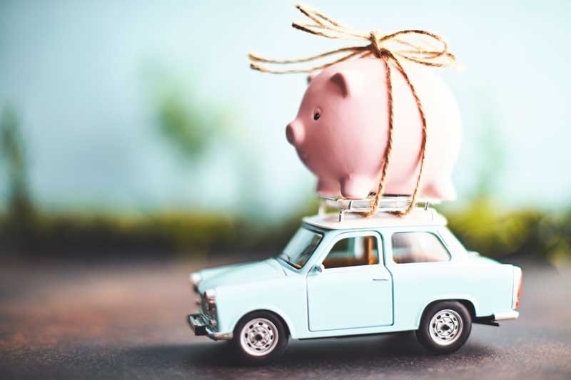 piggy bank on a road trip