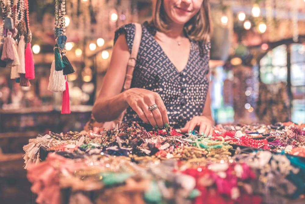 woman shopping in a Bali market for jewelry