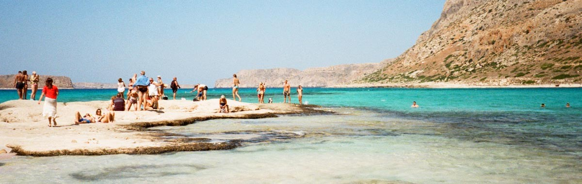 people on spring vacation on beach at Balos Beach, Crete