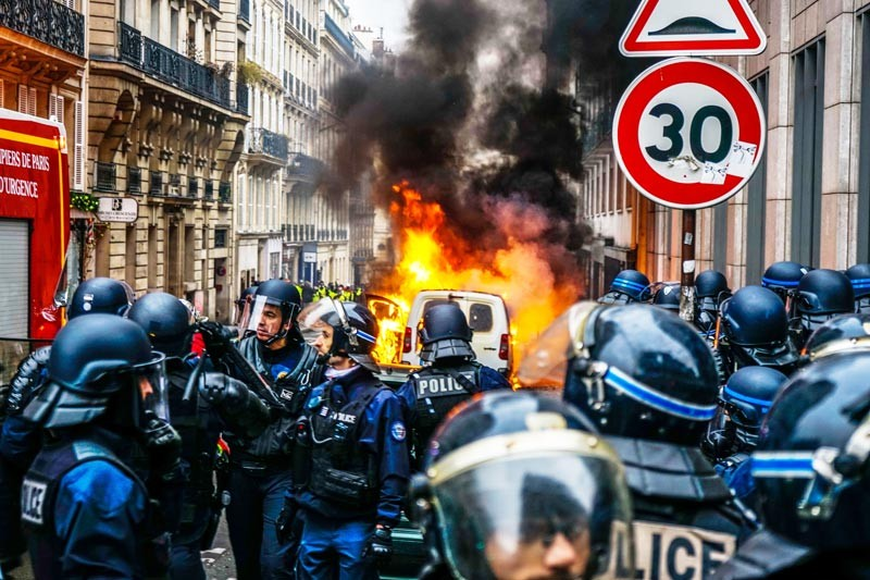 Riot police clash with protesters in Paris, France